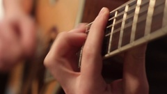 Man playing acoustic guitar close up Stock Footage