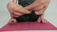 Young sporty man practicing yoga in fitness studio Stock Footage