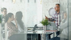 Creative People Pleasantly Discuss Daily Office Issues Sitting at the Big Table. Stock Footage