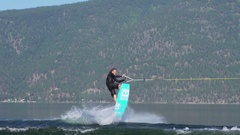 Young man wake boarding on a lake , super slow motion. Stock Footage