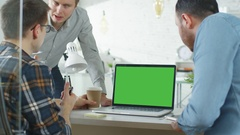 Three Creative Men Discuss Business around Green Screened Laptop.  Stock Footage