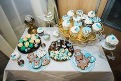 Table with loads of cakes, cupcakes, cookies and cakepops Stock Photos