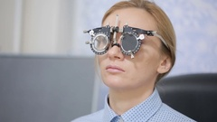 Woman at the reception of an ophthalmologist. the selection of spectacle lenses Stock Footage