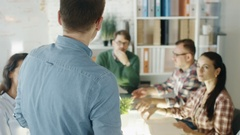 Young Executive Adresses His Colleagues on a Strategic Planning Session.  Stock Footage