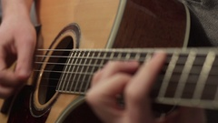 Shallow focus of the technique of the play on acoustic guitar Stock Footage