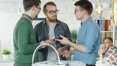 Three Creative Men Discuss Business Matters Passing Tablet to Each Other Stock Footage
