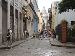 People are walking on central narrow street leading to main square with sight Stock Footage