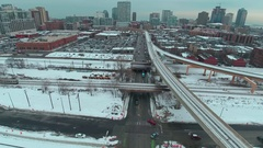 Elevated Train enters left follow out right Stock Footage