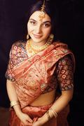 Beauty sweet real indian girl in sari smiling on black backgroun Stock Photos