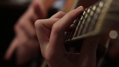 Playing on the acoustic guitar. Musical instrument with guitarist hands Stock Footage