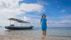 The girl in the blue dress on the ocean. Against the backdrop of turquoise clean Stock Footage