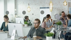 Weekday in a Busy Creative Bureau. Office People Working at Their PCs. Stock Footage
