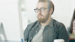 Camera Moves From Close-up of a Man Working at His Desktop to Conference Table Stock Footage