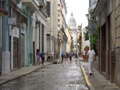 People are walking on central narrow street leading to square with sight Capitol Stock Footage