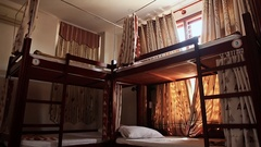 Hotel room with empty bunk beds in a small room of the Asian hostel in Vietnam Stock Footage