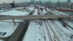 Dolly right above elevated train tracks Stock Footage