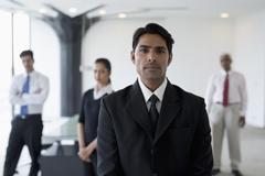 India, Business man in suit standing in front of colleagues Kuvituskuvat
