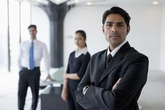 India, Business man standing with arms crossed in front of colleagues Kuvituskuvat