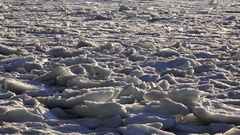 Sea Ice Blobs in Northern Waters Heaving with Waves in Sun HD Stock Footage