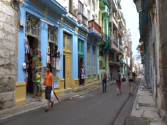 View to street with souvenir shop in center of Havana. Woman seller gift market Stock Footage