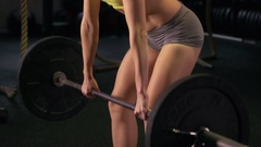 A woman doing deadlift weightlifting at the gym, slow motion. Stock Footage