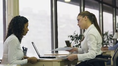 Female boss satisfied with trainee, shaking hand and hiring young lady for job Stock Footage