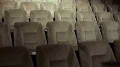 Many rows of empty seats in theater. Large empty cinema with comfortable seats. Stock Footage