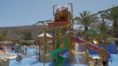 Children at water attraction on resort Stock Footage