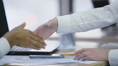Representatives of two companies making a deal and shaking hands, agreement Stock Footage