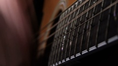 Playing acoustic guitar: particular on hands and guitar strings Stock Footage