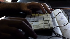 Working in a recording studio: closeup on composer hands using computer keyboard Stock Footage