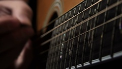 Close-up footage of the hand of a guitarist playing an acoustic guitar Stock Footage