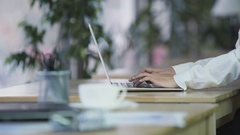 Female working on laptop at office, responsible worker, workplace, refocus Stock Footage