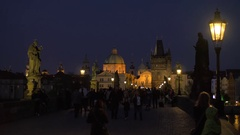 Evening cityscape with walking people on the picturesque Charles Bridge, Prague Stock Footage