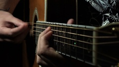 Guitarist playing in the darkness inside a recording studio Stock Footage