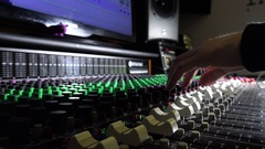 Recording studio: closeup on a music mixing desk Stock Footage