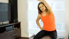 Girl looks tired while exercising on the ball in the joga, steadycam shot Stock Footage