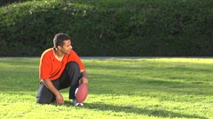 A father teaching his sons how to play American football , super slow motion. Stock Footage
