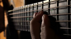 Closeup on hands playing acoustic guitar in a recording studio Stock Footage