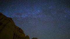 Astro Timelapse of Polaris over Sandstone Canyon in Mojave Desert -Tilt Down- Stock Footage