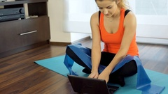 Sporty girl detaches screen from laptop and using as a tablet, steadycam shot Stock Footage