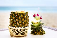 Exotic cocktail, pina colada in a pineapple Stock Photos