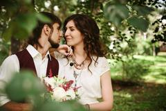 Beautiful loving couple dressed in boho chic style Stock Photos