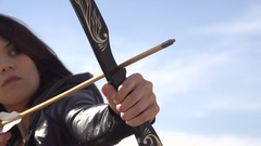 A female archer shooting targets with her bow and arrow , super slow motion. Stock Footage