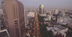 Dusk Over Silom District in Downtown Bangkok, Aerial Drone Shot Stock Footage