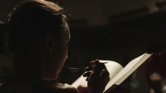 Woman read book in the kitchen. Stock Footage