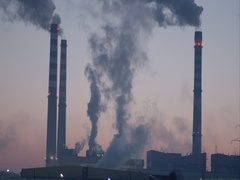 High factory chimneys earn black smoke before sunrise Stock Footage