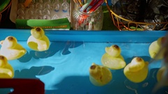 Toy ducks floating on the water Stock Footage