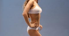 Female body part. Young woman in sports white lingerie Stock Footage