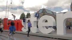 People at popular slogan I amsterdam Stock Footage